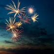 stock-photo-17022754-brightly-colorful-fireworks-in-the-night-sky